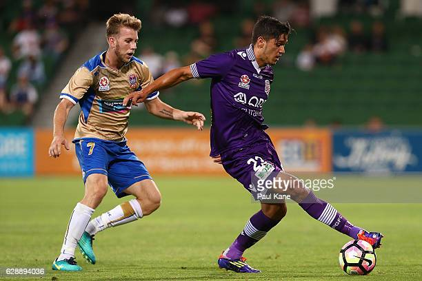 Kosta Petratos of the Glory controls the ball against Andrew Hoole of the Jets during the round 10 ALeague match between the Perth Glory and the...