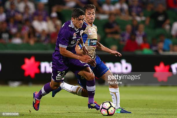 Kosta Petratos of the Glory controls the ball against Mateo Poliak of the Jets during the round 10 ALeague match between the Perth Glory and the...