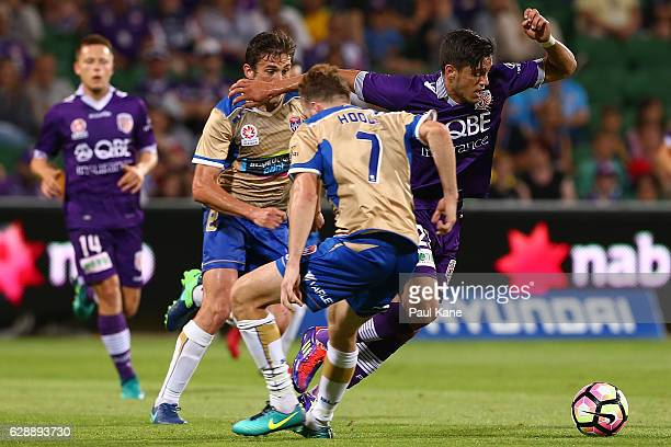 Kosta Petratos of the Glory controls the ball against Mateo Poliak and Andrew Hoole of the Jets during the round 10 ALeague match between the Perth...