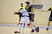 Kosta Savic of Selestat and Matthieu Lamy of Massy during the French Pro D2 playoff semi final first leg match between Massy Essonne and Selestat...