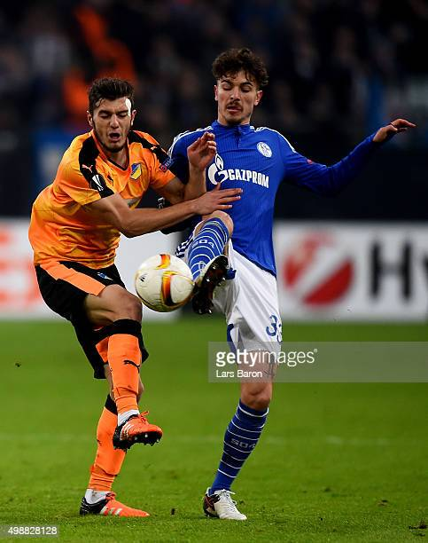Kostakis Artymatas of APOEL challenges Roman Neustaedter of Schalke during the UEFA Europa League Group K match between FC Schalke 04 and APOEL FC on...