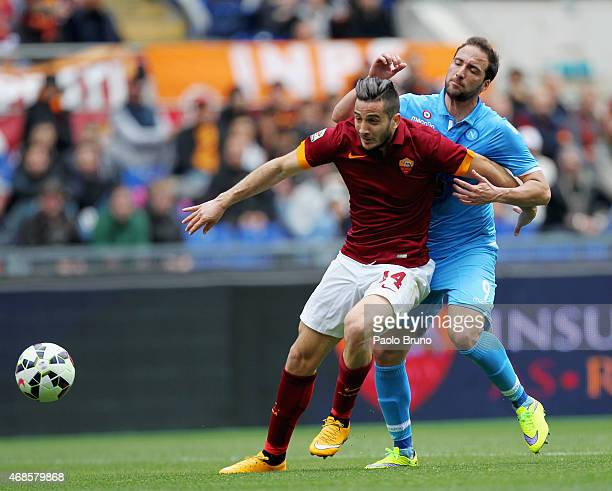 Kostantinos Manolas AS Roma competes for the ball with Gonzalo Higuain of SSC Napoli during the Serie A match between AS Roma and SSC Napoli at...
