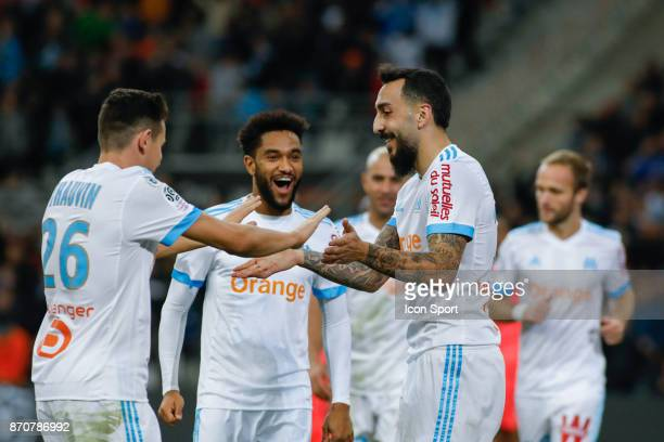 Kostantinos Mitroglou and Jordan Amavi of Marseille celebrates during the Ligue 1 match between Olympique Marseille and SM Caen at Stade Velodrome on...