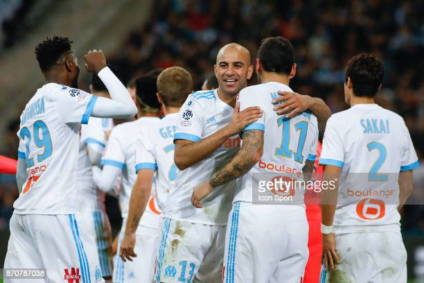 Kostantinos Mitroglou of Marseille celebrates with Aymen Abdennour during the Ligue 1 match between Olympique Marseille and SM Caen at Stade...