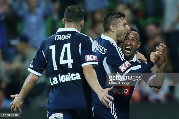 Kostas Barbarouses of the Victory celebrates his goal with James Troisi and Archie Thompson during the round 22 ALeague match between Melbourne...