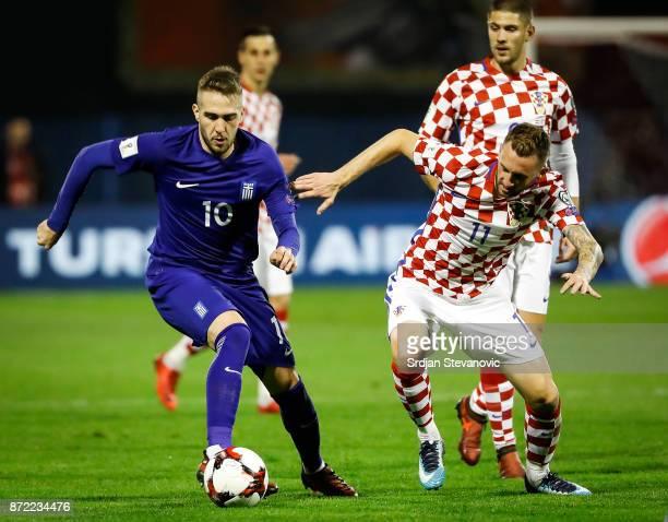 Kostas Fortounis of Geece in action against Marcelo Brozovic of Croatia during the FIFA 2018 World Cup Qualifier PlayOff First Leg between Croatia...