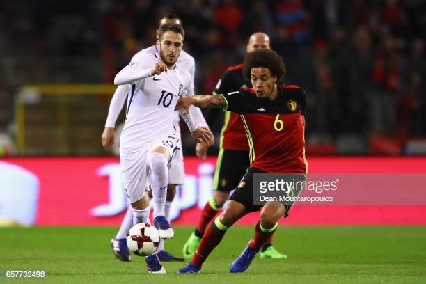 Kostas Fortounis of Greece battles for the ball with Axel Witsel of Belgium during the FIFA 2018 World Cup Group H Qualifier match between Belgium...