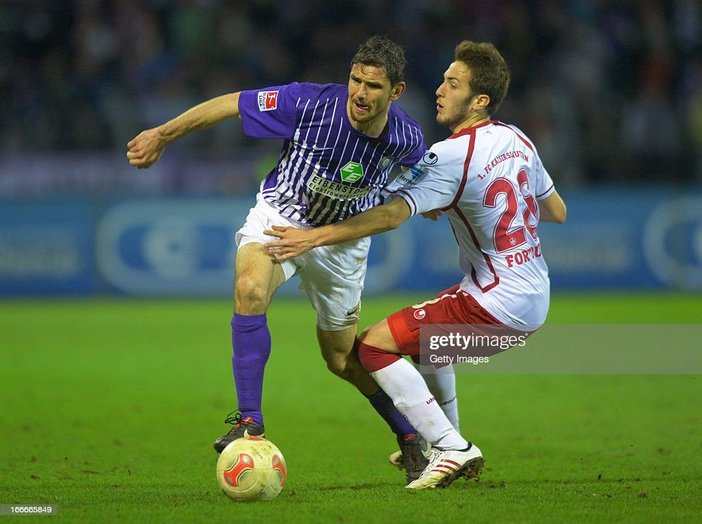 Kostas Fortounis (R) of Kaiserslautern challenges Kevin Schlitte of Aue during the Second Bundesliga match between Erzgebirge Aue and 1. FC Kaiserslautern at Erzgebirgs Stadium on April 15, 2013 in Aue, Germany.