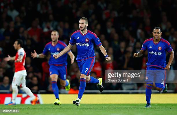 Kostas Fortounis of Olympiacos celebrates the own goal scored by David Ospina of Arsenal during the UEFA Champions League Group F match between...