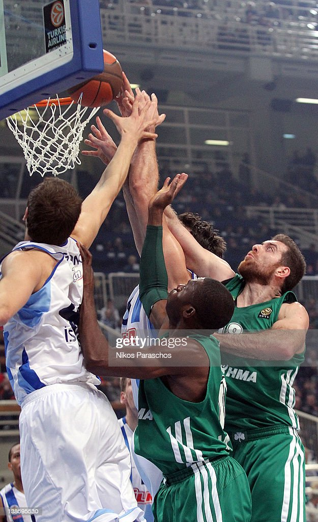 Kostas Kaimakoglou, #18 and <a gi-track='captionPersonalityLinkClicked' href=/galleries/search?phrase=Romain+Sato&family=editorial&specificpeople=220873 ng-click='$event.stopPropagation()'>Romain Sato</a>, #10 of Panathinaikos Athens in action during 2011-2012 Turkish Airlines Euroleague TOP 16 Game Day 4 between Panathinaikos Athens v Fenerbahce Ulker Istanbul at OAKA on February 9, 2012 in Athens, Greece.
