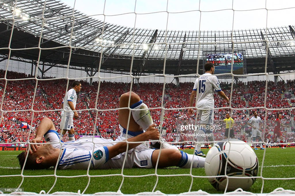 Kostas Katsouranis of Greece lies in the goal after Vaclav Pilar of Czech Republic scored their second goal during the UEFA EURO 2012 group A match between Greece and Czech Republic at The Municipal Stadium on June 12, 2012 in Wroclaw, Poland.