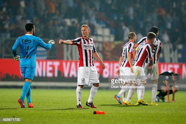 Kostas Lamprou and Jonas Heymans of Willem II celebrate victory after the Dutch Eredivisie match between Willem II Tilburg and NAC Breda at Koning...