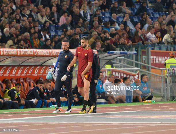 Kostas Manolas leaves the field for injury during the Italian Serie A football match between AS Roma and SSC Napoli at the Olympic Stadium in Rome on...