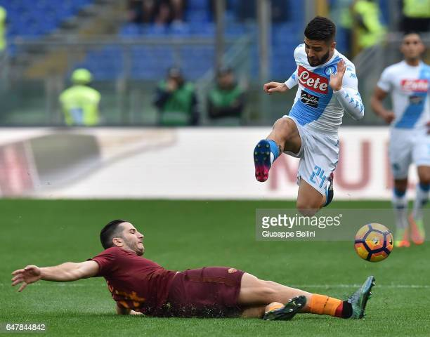 Kostas Manolas of AS Roma and Lorenzo Insigne of SSC Napoli in action during the Serie A match between AS Roma and SSC Napoli at Stadio Olimpico on...