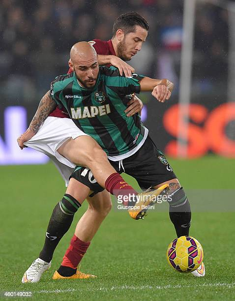 Kostas Manolas of AS Roma and Simone Zaza of US Sassuolo in action during the Serie A match between AS Roma and US Sassuolo Calcio at Stadio Olimpico...