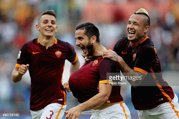Kostas Manolas of AS Roma celebrates Lucas Digne and Radja Nainngolan after scoring the opening goal during the Serie A match between AS Roma and...