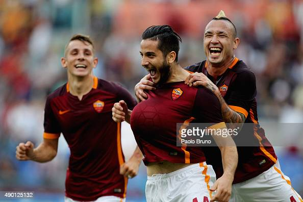 Kostas Manolas of AS Roma celebrates with his teammates Lucas Digne and Radja Nainngolan after scoring the opening goal during the Serie A match...