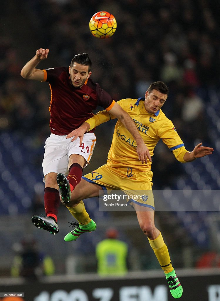 Kostas Manolas (L) of AS Roma competes for the ball with Daniel Ciofani of Frosinone Calcio during the Serie A match between AS Roma and Frosinone Calcio at Stadio Olimpico on January 30, 2016 in Rome, Italy.