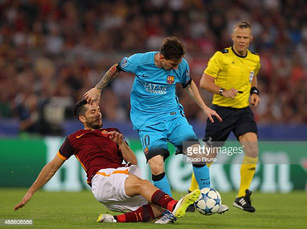 Kostas Manolas of AS Roma competes for the ball with Lionel Messi of FC Barcelona during the UEFA Champions League Group E match between AS Roma and...