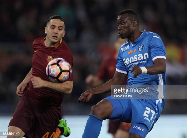 Kostas Manolas of AS Roma competes for the ball with Mama Babe Thiam of Empoli FC during the Serie A match between AS Roma and Empoli FC at Stadio...
