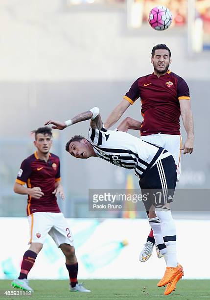 Kostas Manolas of AS Roma competes for the ball with Mario Mandzukic of Juventus FC during the Serie A match between AS Roma and Juventus FC at...