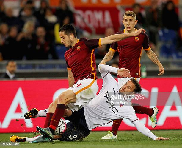 Kostas Manolas of AS Roma competes for the ball with Matteo Brighi of Bologna FC during the Serie A match between AS Roma and Bologna FC at Stadio...