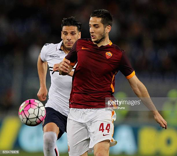 Kostas Manolas of AS Roma competes for the ball with Sergio Floccari of Bologna FC during the Serie A match between AS Roma and Bologna FC at Stadio...