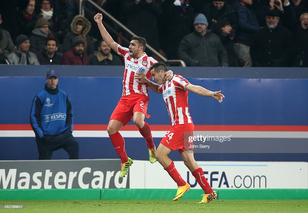 Kostas Manolas of Olympiacos (24) celebrates his goal with his team-mate during the UEFA Champions League Group C match between Paris Saint-Germain FC and Olympiacos FC at the Parc des Princes stadium on November 27, 2013 in Paris, France.