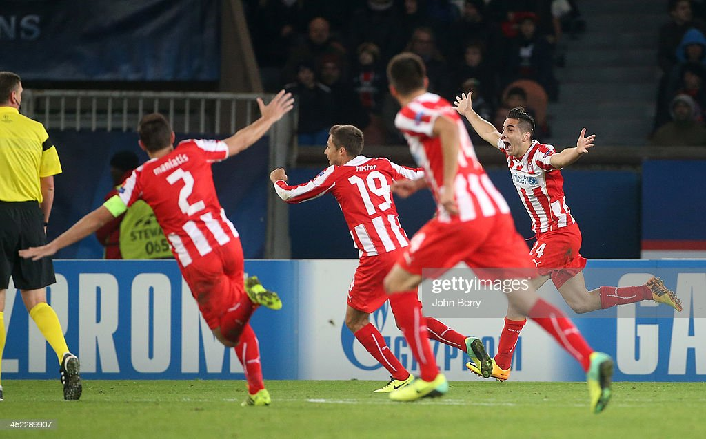 Kostas Manolas of Olympiacos (24) celebrates his goal with his team-mates during the UEFA Champions League Group C match between Paris Saint-Germain FC and Olympiacos FC at the Parc des Princes stadium on November 27, 2013 in Paris, France.