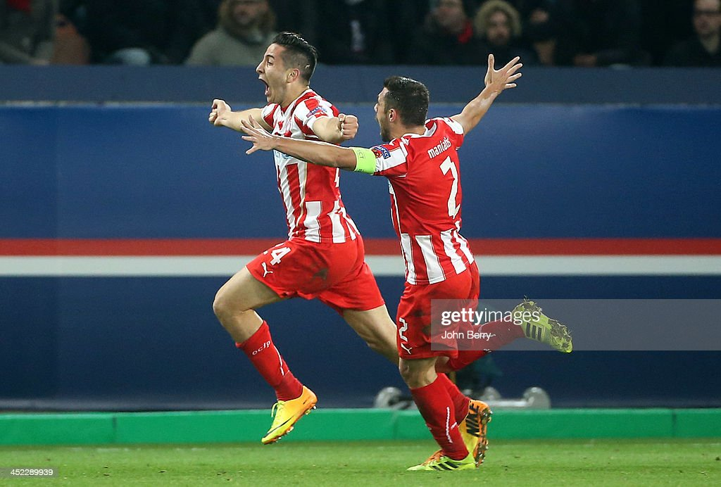 Kostas Manolas of Olympiacos (24) celebrates his goal with his teammates during the UEFA Champions League Group C match between Paris Saint-Germain FC and Olympiacos FC at the Parc des Princes stadium on November 27, 2013 in Paris, France.