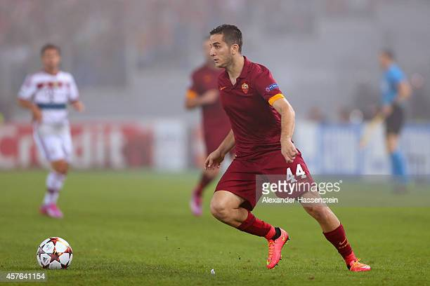 Kostas Manolas of Rom runs with the ball during the UEFA Champions League group E match between AS Roma and FC Bayern Muenchen at Stadio Olimpico on...