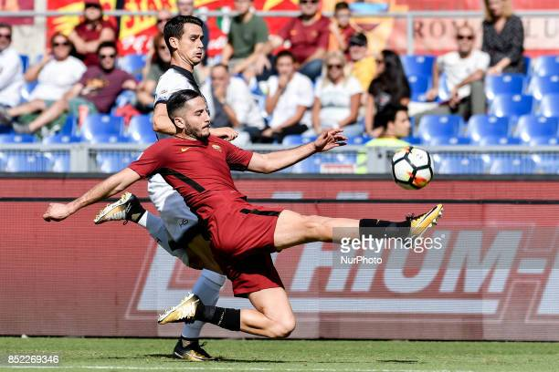 Kostas Manolas of Roma challenges Kevin Lasagna of Udinese during the Serie A match between Roma and Udinese at Olympic Stadium Roma Italy on 23...