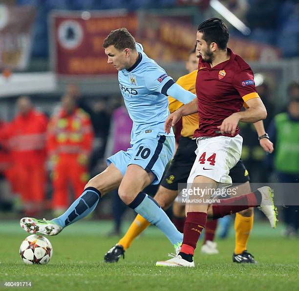 Kostas Manolas of Roma competes for the ball with Edin Dzeko of Manchester City during the UEFA Champions League Group E match between AS Roma and...