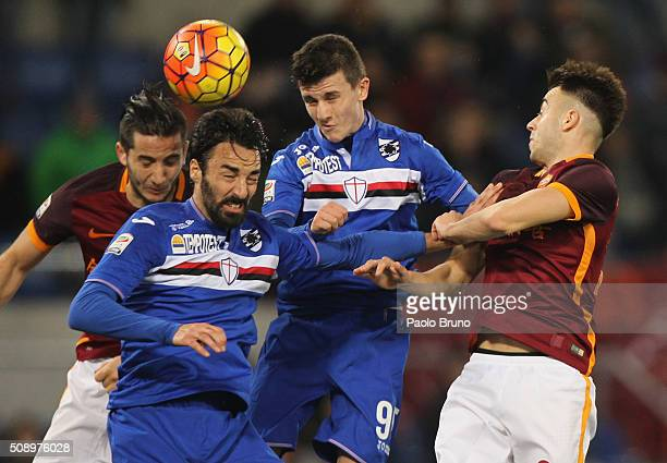 Kostas Manolas with his teammate Stephan EL Shaarawy of AS Roma compete for the ball with Mattia Cassani and David Ivan of UC Sampdoria during the...