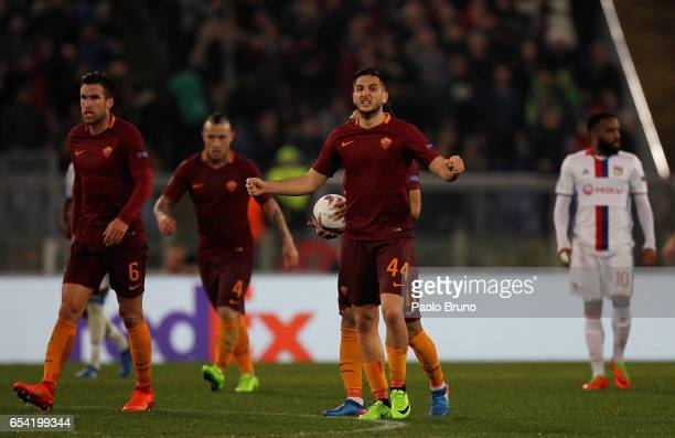 Kostas Manolas with his teammates of AS Roma reacts after the own goal scored by Lucas Tousart of Olympique Lyonnais during the UEFA Europa League...