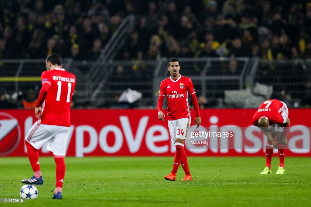 Kostas Mitroglou (L-R), Andre Almeida and Luisao of Benfica react during the UEFA Champions League Round of 16 second leg match between Borussia Dortmund and SL Benfica at Signal Iduna Park on March 8, 2017 in Dortmund, Germany.