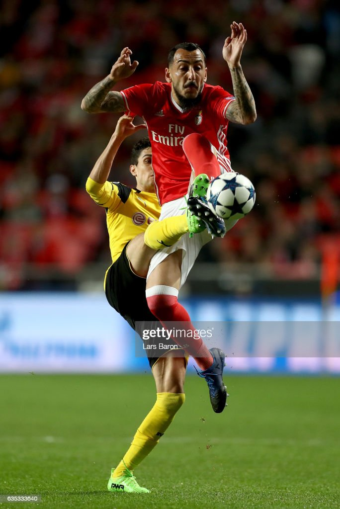Kostas Mitroglou (R) of Benfica battles for the ball with Marc Bartra of Dortmund during the UEFA Champions League Round of 16 first leg match between SL Benfica and Borussia Dortmund at Estadio da Luz on February 14, 2017 in Lisbon, Portugal.