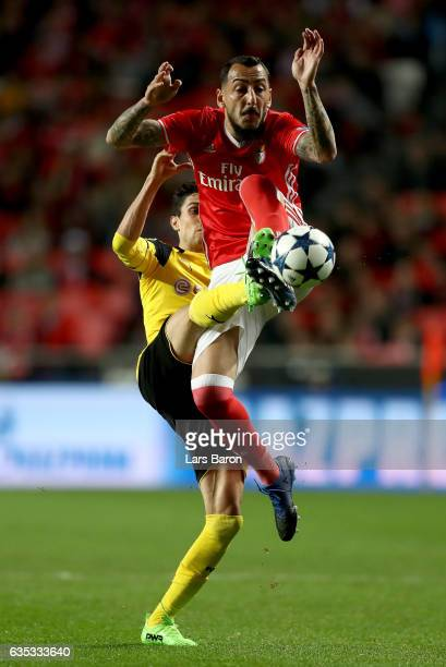 Kostas Mitroglou of Benfica battles for the ball with Marc Bartra of Dortmund during the UEFA Champions League Round of 16 first leg match between SL...