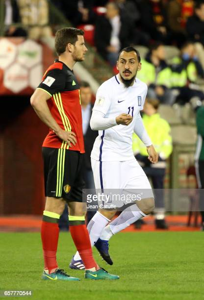 Kostas Mitroglou of Greece celebrates his goal while Jan Vertonghen of Belgium looks on during the FIFA 2018 World Cup Qualifier between Belgium and...