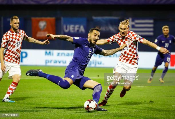 Kostas Mitroglou of Greece in action against Domagoj Vida of Croatia during the FIFA 2018 World Cup Qualifier PlayOff First Leg between Croatia and...