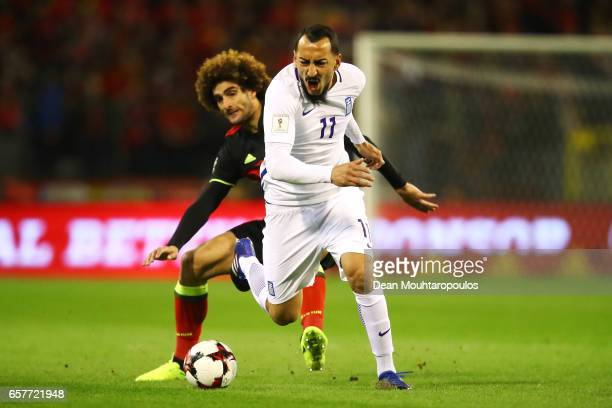 Kostas Mitroglou of Greece is fouled by Marouane Fellaini of Belgium during the FIFA 2018 World Cup Group H Qualifier match between Belgium and...