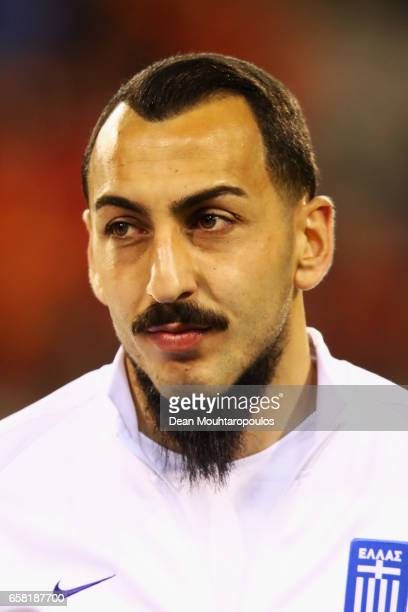 Kostas Mitroglou of Greece stands for the national anthem prior to the FIFA 2018 World Cup Group H Qualifier match between Belgium and Greece at...