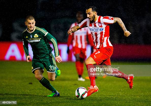 Kostas Mitroglou of Olympiacos attacks as Mladen Petric of Panathinaikos defends during the Superleague match between Panathinaikos FC and Olympiacos...