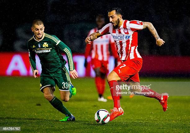 Kostas Mitroglou of Olympiacos attacks as Mladen Petric of Panathinaikos defends during the Superleague match between Panathinaikos FC and Olympiacos...
