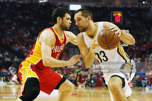HOUSTON TX DECEMBER18 Kostas Papanikolaou of the Houston Rockets defends against Ryan Anderson of the New Orleans Pelicans during their game at the...