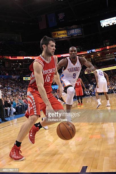 Kostas Papanikolaou of the Houston Rockets drives against the Oklahoma City Thunder on November 16 2014 at Chesapeake Energy Arena in Oklahoma City...