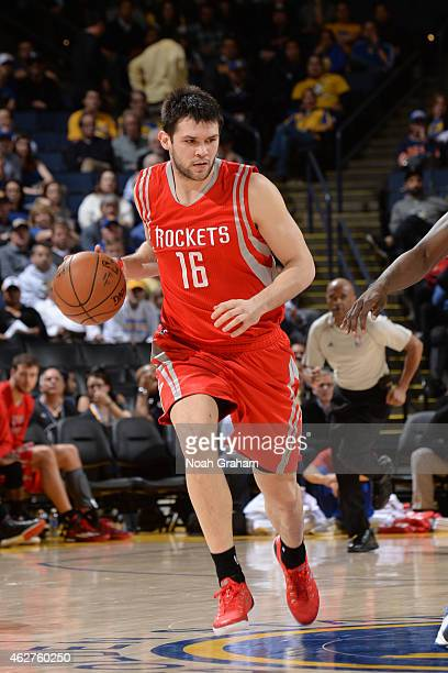 Kostas Papanikolaou of the Houston Rockets drives against the Golden State Warriors on January 21 2015 at Oracle Arena in Oakland California NOTE TO...