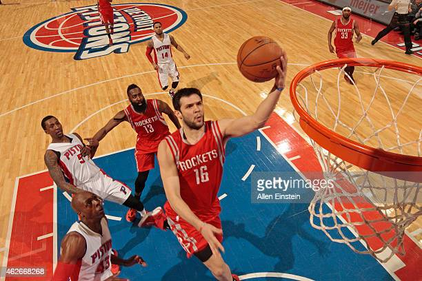 Kostas Papanikolaou of the Houston Rockets drives to the basket against the Detroit Pistons on January 31 2015 at The Palace of Auburn Hills in...