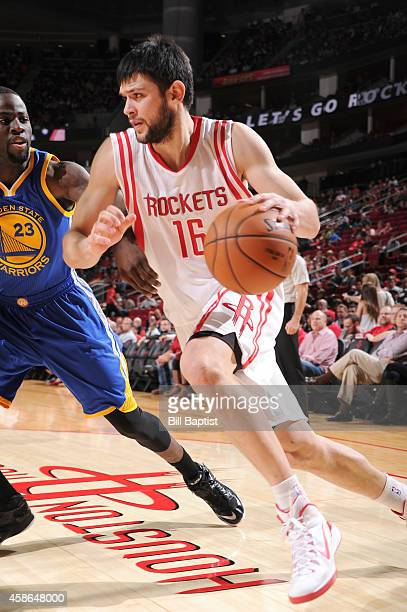 Kostas Papanikolaou of the Houston Rockets handles the ball against the Golden State Warriors during the game on November 8 2014 at the Toyota Center...