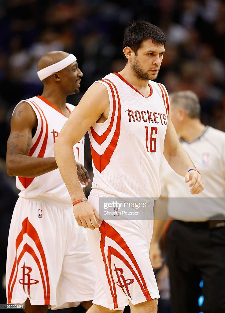 <a gi-track='captionPersonalityLinkClicked' href=/galleries/search?phrase=Kostas+Papanikolaou&family=editorial&specificpeople=5969202 ng-click='$event.stopPropagation()'>Kostas Papanikolaou</a> #16 of the Houston Rockets reacts with <a gi-track='captionPersonalityLinkClicked' href=/galleries/search?phrase=Jason+Terry&family=editorial&specificpeople=201734 ng-click='$event.stopPropagation()'>Jason Terry</a> #31 during the NBA game against the Phoenix Suns at US Airways Center on January 23, 2015 in Phoenix, Arizona. The Rockets defeated the Suns 113-111.